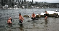 The Libby Polar Bears celebrated the new year with their annual New Year plunge in the Kootenai River Sunday, January 1. Four people braved the frigid water: Rick Klin, Steve Sonju, Alan Gerstenecker and Eva Stoneroad. Photo by Maggie Craig, LibbyMT.com.