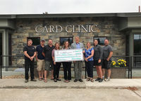 (L-R) LeRoy Thom, Jason Williams, Jon Roberts, Jamie Rosling, Donna Williams, Brad Black, Tracy McNew, Erica Hartley, and Joe Miller pose with the $24,381.94 check donated to the CARD Clinic by the CARD Foundation. The money was raised during this year's Big Sky Bash and it will be used to help fund the clinic's new parking lot. Photo courtesy CARD.
